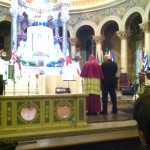 Bp. Hanchon _leads_ the assembly in prayer to Our Lady