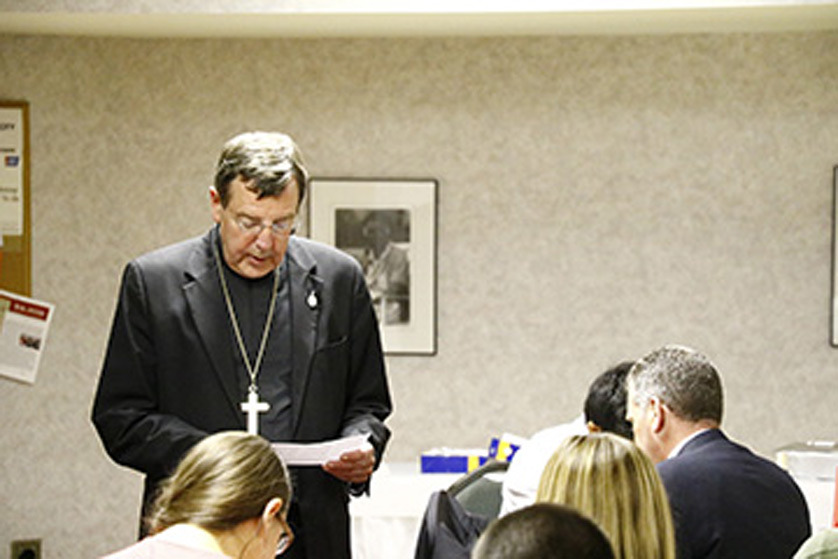 Archbishop Allen H. Vigneron, who offered the homily during the July 31 Mass, speaks to approximately 65 young adults of Juventutem during a post-Mass dinner and social at the cathedral.